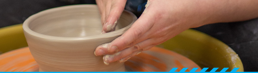 PCC student using pottery wheel